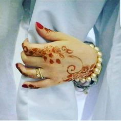 Mehndi is an art where an artist applies various henna tattoos on a girl's hands feet and other body parts. Mehndi Designs for bridals are amazing body art. Mehndi Desgin, Modern Mehndi Designs, Beautiful Mehndi Design, Arabic Mehndi Designs, Bridal Mehndi Designs, Henna Designs, Hand Pictures, Love Pictures, Romantic Couples