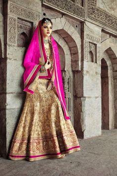 Gold raws silk choli with golden flared lehenga