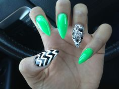 Stiletto Irish Green Nails with Chevron and Diamond/Spiked accent nails. My nail artist is a genius!!