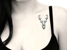 A small tattoo of tine deer head on the chest of the wearer and it looks sexy.