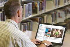 Man using Pima County Public Library's new website on laptop. Really impressed with the variety  & vigor. Take a look for yourself