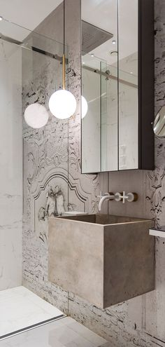 In this bathroom, a deep concrete sink appears to float and a glass shower door allows the mural to carry on uninterrupted into the shower. Interior, Glass Shower Doors, Concrete Sink, Shower Doors, Round Mirror Bathroom, Small Bathroom, Modern Bathroom, Bathroom Decor, Bathroom Inspiration