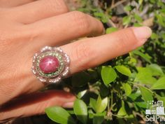 SellPin.com: Pins for Sale by Owner: Beautiful star ruby. Moderate red color surrounded with tsavorite garnets and white sapphires. Ruby is 6.5 cts, ring is a size 6, everything set in sterling silver Price $500. $500