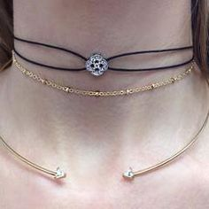 Simple and delicate, this faux leather draw string necklace features a center flower adornment. The beautiful center flower is a sterling silver piece dipped in 18K gold with a crystal stone and surro