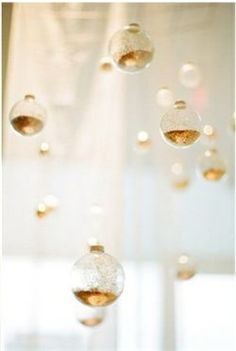 Clear Ornaments filled with gold glitter-how great and easy are these?! Perhaps these could be hanging amongst the ombré paper flower and/or ribbon garland for the arch. The sunlight would just catch that glitter and make them sparkle like crazy!!