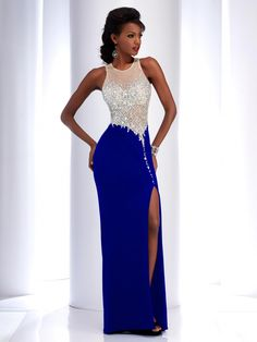 This pageant or prom sheath dress has an illusion neckline, with a Natural Jersey skirt that comes in red, black and blue.