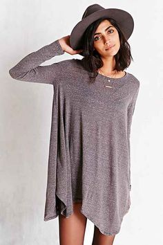 BDG Heathered Shark Bite T-Shirt Dress - Urban Outfitters $59.00 Effortlessly cool + classic t-shirt dress from BDG cut in a loose, swingy shift silhouette. In a soft heather knit with long sleeves and an asymmetrical shark-bite hemline.