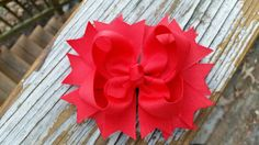 Check out this item in my Etsy shop https://www.etsy.com/listing/219089176/boutique-red-spike-tbb-bow-hair-clip