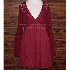 FREE PEOPLE Dress Eyelet Lace Bell Sleeve Swing Size Medium. New with tags. $128 Retail + Tax.  Stunning dark pink dress with sheer floral mesh bodice and pleated skirt.  V neckline with button closure detailing.  Lined with a removable slip.  Rayon.  Imported.     ❗️ Please - no trades, PP, holds, or Modeling.    Bundle 2+ items for a 20% discount!    Stop by my closet for even more items from this brand!  ✔️ Items are priced to sell, however reasonable offers will be considered when…