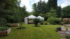 What a beautiful sunny day we had in Annesley when we went to set up a few marquees for a customer's garden party. They wanted one of our hexagon shaped marquees and one of our small square marquees to be joined onto the side which would be the food and drinks area. As well as hiring the marquees they also hired some carpet for the flooring, some lights, some tables for the buffet tables and to sit at, and 20 chairs for everyone coming to the event to sit down and relax.