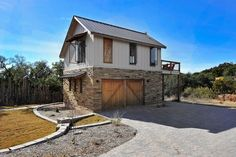 Texas hill country decor exterior contemporary with wood fence board and batten siding