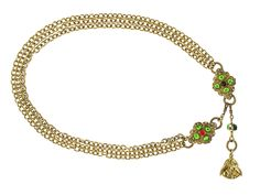 Chanel Early Vintage Multi-Strand Gripoix Belt 1970s - Chanel Early Vintage Multi-Strand Gripoix Belt is an extremely rare piece. This item features gold tone multi-strand detailing with green and red gripoix detailing at the center, 'CC' pendant logo hangs below. Circa 1970's. Please note: There is light tarnishing to some areas of the belt.  Overall Condition: Very Good, slight tarnishing. Material: Goldtone, Gripoix Glass. Includes: None. Origin: France. Production Year: Unknown. Date/...