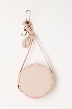 "- Benah for Karen Walker - Inner pocket - Zip closure - Leather; cotton lining - 8"" diameter, 2""D - 19"" strap drop - Imported"