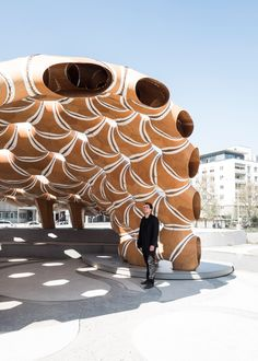 Researchers and students from the University of Stuttgart employed robots to mould and stitch together this laminated plywood pavilion