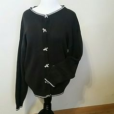 Zebra button sweater Those buttons are cute as a zebra!  6 wooden zebra buttons add a nice touch to this black cardigan with white trim. Tag says medium but fits more like a large. The Eagle's Eye Sweaters Cardigans
