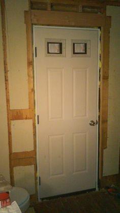 Door installed into half-bath.