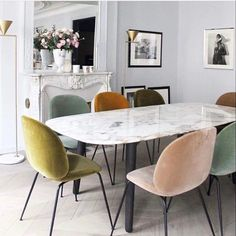 Top trending pins for June, see the rest of the favourites for interiors and style inspiration! Modern dining room interior setup with marble dining ding table and multi toned velvet dining chairs Dining Room Design, Dining Room Chairs, Coloured Dining Chairs, Mismatched Dining Chairs, Office Chairs, Mixed Dining Chairs, Colorful Chairs, Modern Dining Chairs, Elle Decor
