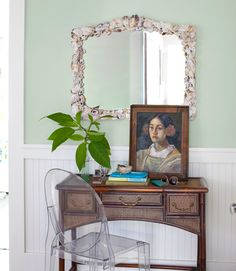 Beach House Decorating - Beach Home Decor - Country Living The owner of this California home spotted the shell mirror at an L.A. gift shop. Philippe Starck's clear Ghost chair tempers the solidity of a Chinese rattan desk.  Local artist Inglis Kelley painted the portrait.