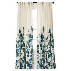 Very nice white and teal curtains.