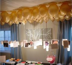 Pictures tied to balloons...cute for a wedding shower.