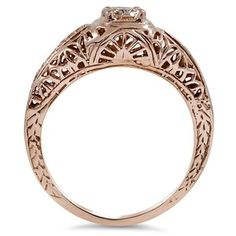 This intricately detailed diamond solitaire from the Edwardian era showcases a beautiful round brilliant diamond set in stunning rose gold. ...