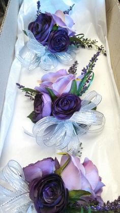 Lavender and purple corsage with silver ribbon