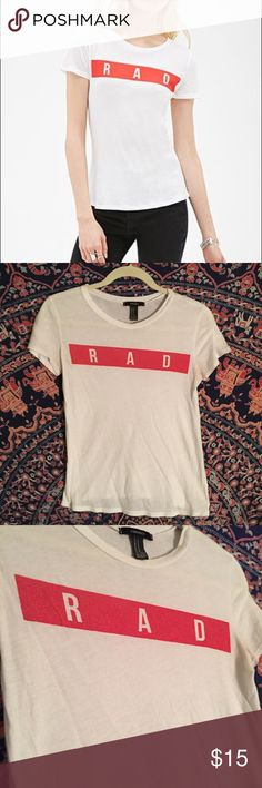 Rad T shirt This is a super cool and effortless shirt. I would always get compliments on this shirt and everyone was asking me where to get it. This shirt is gently worn I took very good care of it.Leave an offer it will most likely be accepted. Comment if you would like free vans, adidas, etc stickers in your package. Forever 21 Tops Tees - Short Sleeve
