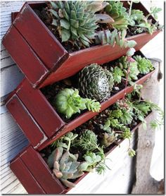 This would be an interesting way to mount window boxes on the potting shed so that the push up then out windows could open.