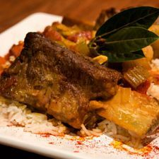 Beef Short Ribs  Ingredients 3 to 4 lb. beef short ribs with bone 1 tbsp. olive oil 2 1/2 cups water, divided 1 (6 oz.) can tomato paste 1 cup ketchup 1 garlic clove, minced 3/4 cup packed brown sugar 1/2 cup chopped onion 1/2 cup vinegar 2 tbsp. prepared mustard 1 1/2 tsp. salt