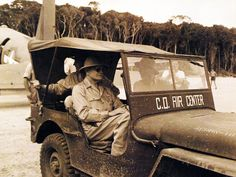 Admiral William P. Halsey, Jr., Commander, South Pacific Fleet and forces.  Inspecting Barakoma Field, Vella Lavella Island, during his tour of Allied bases in the Solomons.  Halsey is shown in the jeep.  Photograph received November 10. 1943.    U.S. Navy photograph, now in the collections of the National Archives.