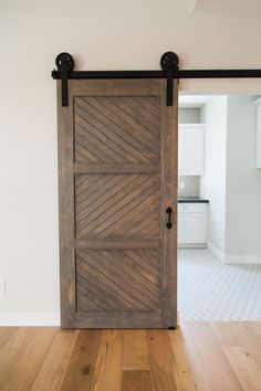 Custom built sliding barn door - by Rafterhouse. Phoenix, AZ