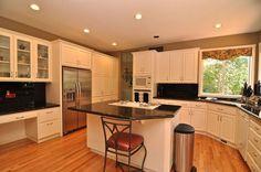 Traditional Kitchen with U-shaped, Raised panel, Hardwood floors, Undermount Sink, Simple Granite, Glass panel, Breakfast bar
