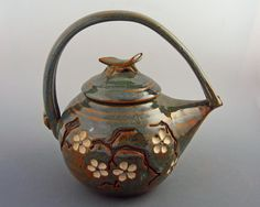 white flowered tea pot