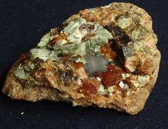 Spessartine, the honey colored crystals on a gneissic matrix, Rio Grande do Norte, Brazil