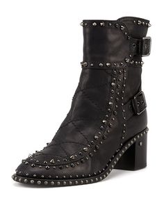 """Laurence Dacade matte calfskin boot with gunmetal studs. Tonal crisscross topstitching adorns vamp. 6""""H shaft with double-buckled outer. 2"""" flat stacked heel with stud detail. Round toe. Studded midso"""