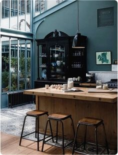 ...love the windows, island and how the china cabinet and stools tie everything together in this kitchen.
