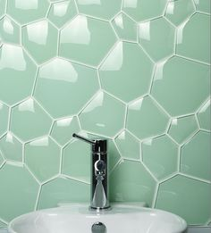 I love the idea of the irregular tiles for a bathroom or backsplash. Love the color too