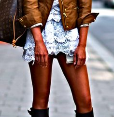 Brown leather bomber, white lace mini-skirt