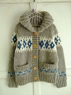 i love the way the colorwork cuts across the pockets and the giant collar. by socorro