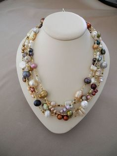 A 67 inch necklace of pearls in a variety of colors, shapes and sizes. It can be worn in a variety of ways from long and doubled to a four strand necklace. The clasp is a gold filled lobster claw. Pearl Jewelry, Wire Jewelry, Jewelry Crafts, Beaded Jewelry, Jewelery, Vintage Jewelry, Jewelry Necklaces, Handmade Jewelry, Diy Bridal Jewellery