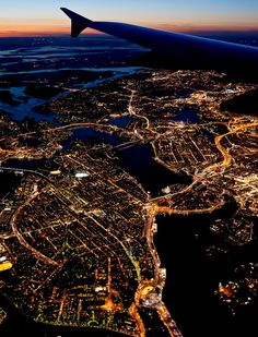 Stockholm by night. Seeing city lights from a plane has always been one our favorite part of travel