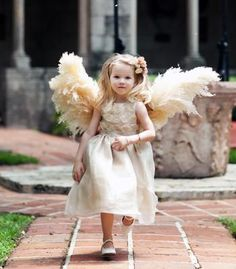 """The bride created """"angel wings"""" for her flower girl out of dried pampas!"""