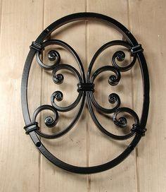 Oval Speakeasy / Window Grille with decorative scroll work