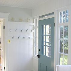 """Beadboard wall with hooks. Floor: Quartzite mix of light tan, white quartz, soft green, turquoise and rust (requires regular sealing). Wall color: Sarah Richardson's """"Promise"""", a warm light dove gray. Door color: BM """"Boca Raton Blue"""" 711."""