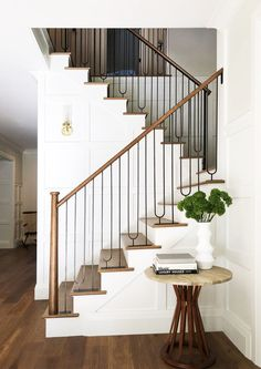 Simple black metal stair rail with wood cap for warmth. #modernfarmhouse #modernhome #shiplap