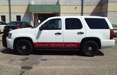 Simple graphics along the bottom of this SUV make a big statement for Flight Creative Media