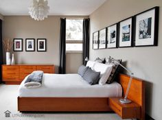 Uncluttered bedroom with a modern white IKEA pendant ceiling lamp.