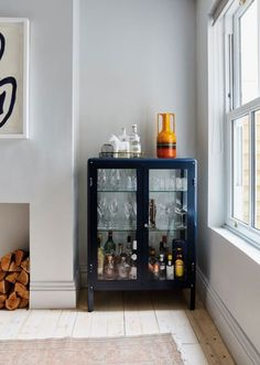 A smart drinks cabinet is a must. Fill with your best glassware and and be the e… A smart drinks cabinet is a must. Fill with your best glassware and and be the envy of all your friends. Living Room Bar, Home Living, Living Room Designs, Dining Room With Bar, Dining Room Storage, Living Room Cabinets, Kitchen Living, Small Living, Modern Living