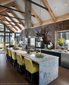 Kitchen divine - HGTV dream home 2014. By Ethan Allen- Thomas Barstools in yellow leather create an eclectic style that's easy to live with.