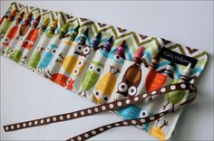 Love this idea and pattern.  I would love one of these for Benjamin.  I'd even concede and get him one of the ones with trucks or planes.  They come in 16 or 8 crayon varieties.